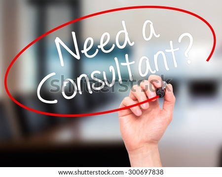 Man Hand writing Need a Consultant? with black marker on visual screen. Isolated on office. Business, technology, internet concept. Stock Photo - stock photo