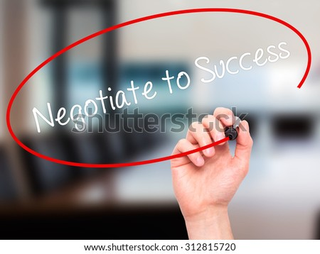 Man Hand writing Negotiate to Success with black marker on visual screen. Isolated on office. Business, technology, internet concept. Stock Photo - stock photo