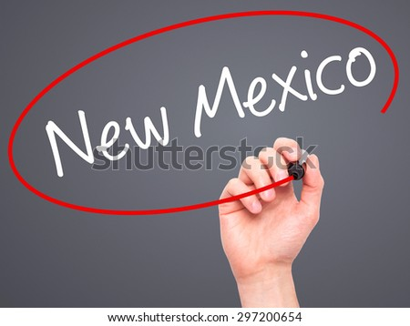 Man Hand writing New Mexico with black marker on visual screen. Isolated on grey. Business, technology, internet concept. Stock Photo - stock photo