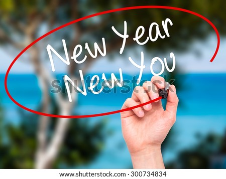 Man Hand writing New Year New You with black marker on visual screen. Isolated on nature. Business, technology, internet concept. Stock Photo - stock photo