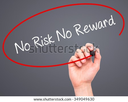 Man Hand writing No Risk No Reward with black marker on visual screen. Isolated on background. Business, technology, internet concept. Stock Photo