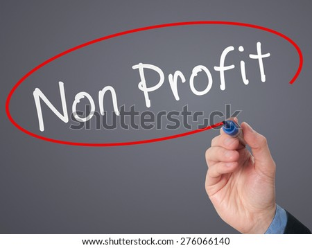 Man Hand writing Non Profit with marker on virtual screen. Business, technology, internet concept. Stock Photo - stock photo