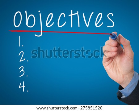 Man Hand writing Objectives to do list with marker. Business, internet concept. stock Image - stock photo