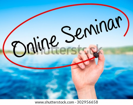 Man Hand writing Online Seminar with black marker on visual screen. Isolated on nature. Business, technology, internet concept. Stock Photo - stock photo