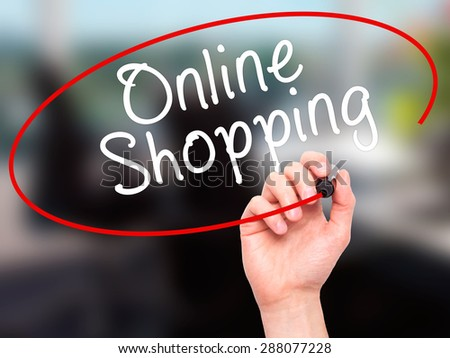 Man Hand writing Online Shopping with black marker on visual screen. Isolated on office. Business, technology, internet concept. Stock Image - stock photo