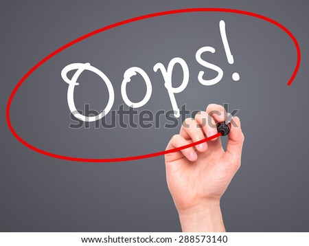 Man Hand writing Oops! with black marker on visual screen. Isolated on grey. Business, technology, internet concept. Stock Image - stock photo