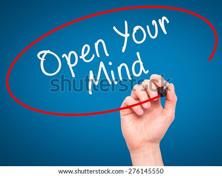Man hand writing Open Your Mind with marker on transparent screen. Business, internet, technology concept. Isolated on blue. Stock Image - stock photo