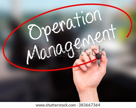 Man Hand writing Operation Management with black marker on visual screen. Isolated on background. Business, technology, internet concept. Stock Photo - stock photo