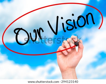Man Hand writing Our Vision with black marker on visual screen. Isolated on sky. Business, technology, internet concept. Stock Photo - stock photo