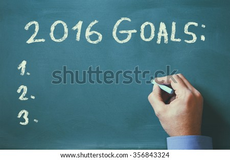 man hand writing over chalkboard the phrase 2016 goals - stock photo