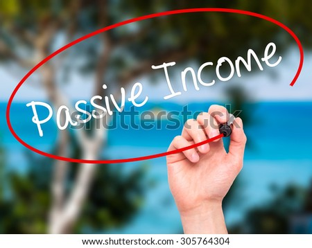 Man Hand writing Passive Income with black marker on visual screen. Isolated on nature. Business, technology, internet concept. Stock Photo - stock photo