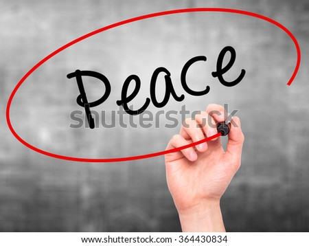 Man Hand writing Peace  with black marker on visual screen. Isolated on background. Business, technology, internet concept. Stock Photo