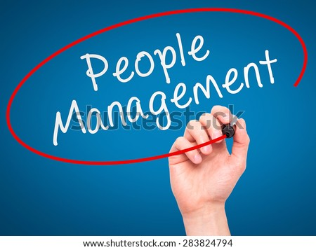 Man Hand writing People Management with marker on transparent wipe board. Isolated on blue. Business, internet, technology concept. Stock Photo