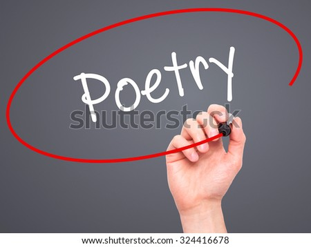 Man Hand writing Poetry  with black marker on visual screen. Isolated on grey. Business, technology, internet concept. Stock Photo - stock photo