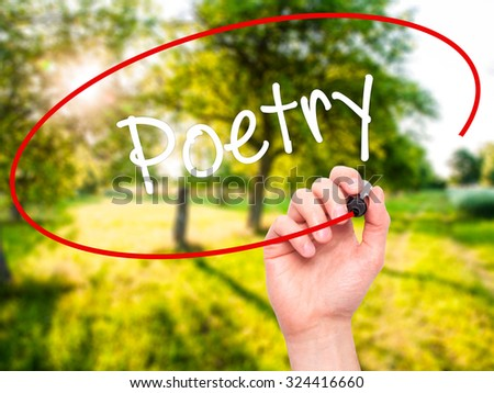 Man Hand writing Poetry  with black marker on visual screen. Isolated on nature. Business, technology, internet concept. Stock Photo - stock photo