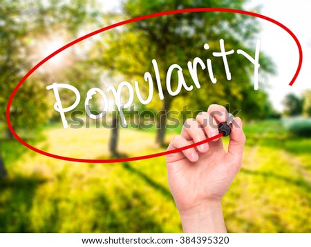 Man Hand writing Popularity with black marker on visual screen. Isolated on background. Business, technology, internet concept. Stock Photo - stock photo