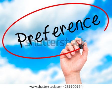 Man Hand writing Preference with black marker on visual screen. Isolated on sky. Business, technology, internet concept. Stock Image - stock photo