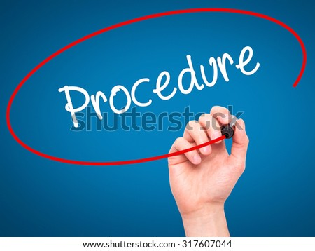 Man Hand writing Procedure with black marker on visual screen. Isolated on blue. Business, technology, internet concept. - stock photo