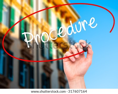 Man Hand writing Procedure with black marker on visual screen. Isolated on city. Business, technology, internet concept. - stock photo