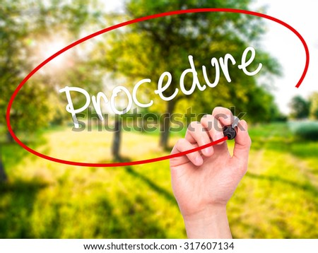 Man Hand writing Procedure with black marker on visual screen. Isolated on nature. Business, technology, internet concept. - stock photo