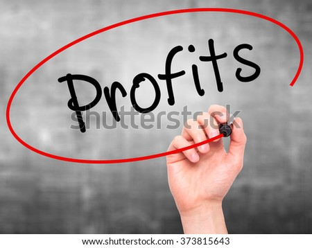 Man Hand writing Profits with black marker on visual screen. Isolated on background. Business, technology, internet concept. Stock Photo