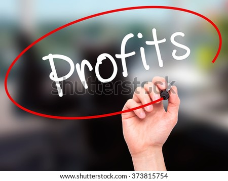 Man Hand writing Profits with black marker on visual screen. Isolated on background. Business, technology, internet concept. Stock Photo - stock photo