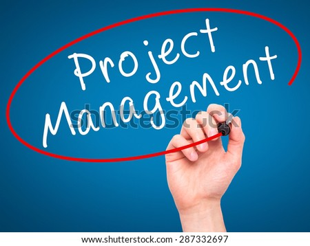 Man Hand writing Project Management with marker on transparent wipe board. Isolated on blue. Business, internet, technology concept. Stock Photo