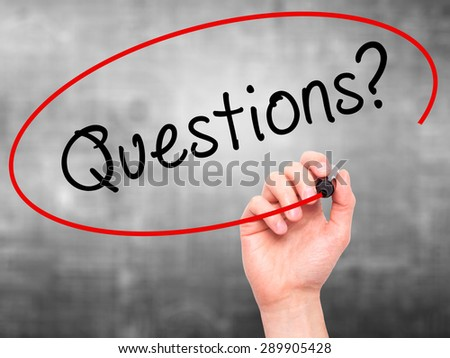Man Hand writing Questions? with black marker on visual screen. Isolated on grey. Business, technology, internet concept. Stock Image - stock photo