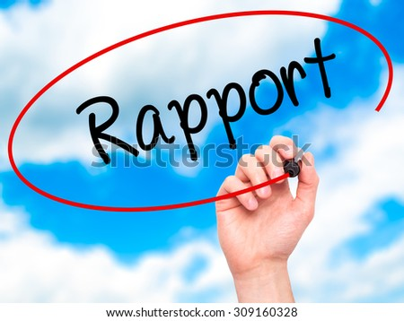 Man Hand writing Rapport with black marker on visual screen. Isolated on sky. Business, technology, internet concept. Stock Photo - stock photo