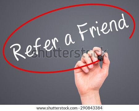 Man Hand writing Refer a Friend  with black marker on visual screen. Isolated on grey. Business, technology, internet concept. Stock Image - stock photo