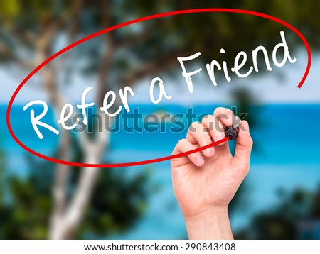 Man Hand writing Refer a Friend  with black marker on visual screen. Isolated on nature. Business, technology, internet concept. Stock Image - stock photo