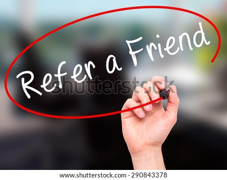 Man Hand writing Refer a Friend  with black marker on visual screen. Isolated on office. Business, technology, internet concept. Stock Image - stock photo