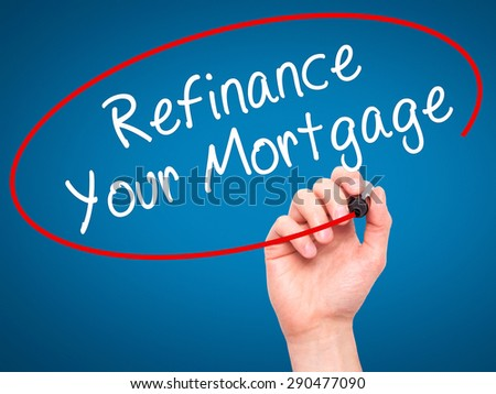Man Hand writing Refinance Your Mortgage with black marker on visual screen. Isolated on blue. Business, technology, internet concept. Stock Image - stock photo