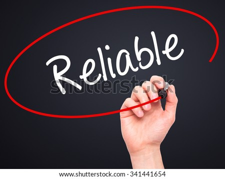 Man Hand writing Reliable with black marker on visual screen. Isolated on black. Business, technology, internet concept. Stock Photo - stock photo