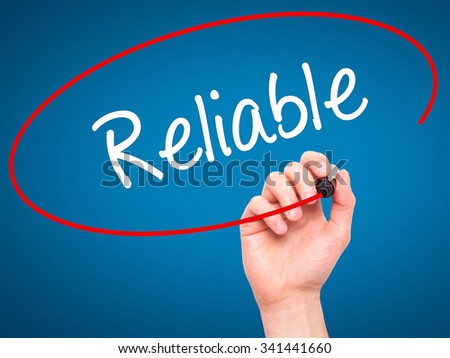 Man Hand writing Reliable with black marker on visual screen. Isolated on blue. Business, technology, internet concept. Stock Photo - stock photo