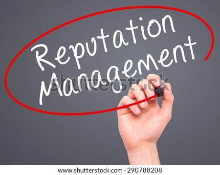 Man Hand writing Reputation Management with black marker on visual screen. Isolated on grey. Business, technology, internet concept. Stock Image