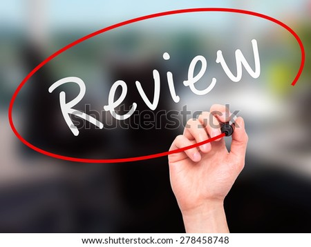 Man Hand writing Review with marker on transparent wipe board. Isolated on office. Business, internet, technology concept. Stock Photo - stock photo