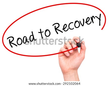 Man Hand writing Road to Recovery with black marker on visual screen. Isolated on white. Business, technology, internet concept. Stock Image - stock photo