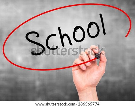 Man Hand writing School with marker on transparent wipe board. Isolated on grey. Business, internet, technology concept. Stock Photo