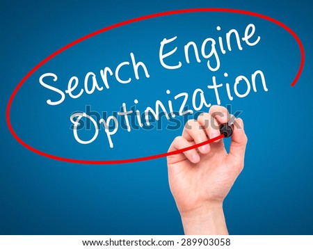 Man Hand writing Search Engine Optimization with black marker on visual screen. Isolated on blue. Business, technology, internet concept. Stock Image - stock photo