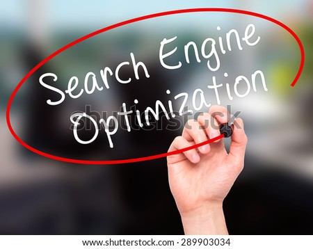 Man Hand writing Search Engine Optimization with black marker on visual screen. Isolated on office. Business, technology, internet concept. Stock Image - stock photo