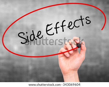 Man Hand writing Side Effects with black marker on visual screen. Isolated on grey. Business, technology, internet concept. Stock Photo - stock photo