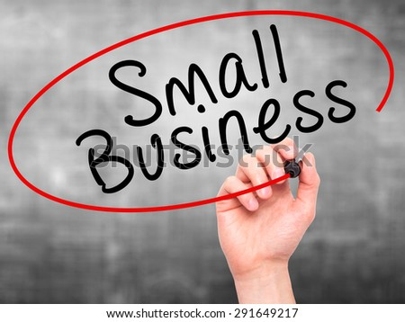 Man Hand writing Small Business with black marker on visual screen. Isolated on grey. Business, technology, internet concept. Stock Image