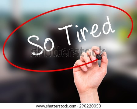 Man Hand writing So Tired with black marker on visual screen. Isolated on office. Business, technology, internet concept. Stock Image  - stock photo