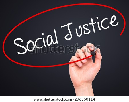 Man Hand writing Social Justice with black marker on visual screen. Isolated on black. Business, technology, internet concept. Stock Photo - stock photo