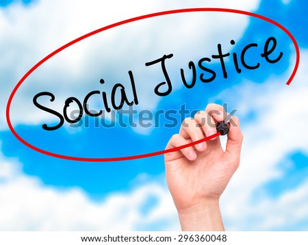 Man Hand writing Social Justice with black marker on visual screen. Isolated on sky. Business, technology, internet concept. Stock Photo - stock photo