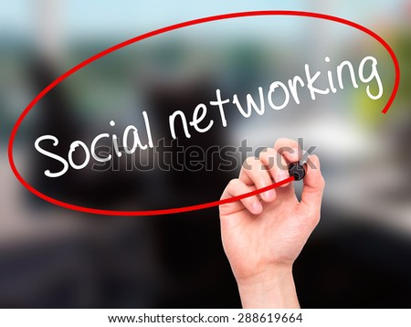 Man Hand writing Social networking with black marker on visual screen. Isolated on office. Business, technology, internet concept. Stock Image - stock photo