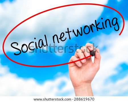 Man Hand writing Social networking with black marker on visual screen. Isolated on sky. Business, technology, internet concept. Stock Image - stock photo