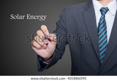 Man Hand writing Solar Energy black marker on visual screen. Isolated on background. Business, technology, internet concept.  - stock photo
