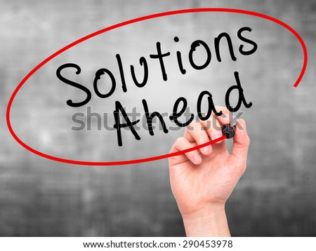 Man Hand writing Solutions Ahead with black marker on visual screen. Isolated on grey. Learn, technology, internet concept. Stock Image - stock photo